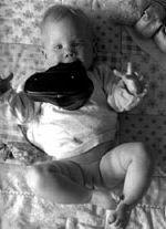 Abdukčně flekční poloha u ležícího miminka